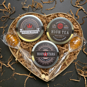 For Him Heart Tea Gift with 3 Mini Tins of Rise and Shine High Caffeine Earl Grey Supreme Black Tea, Relax and Reboot Mild Caffeine Elderberry Energy Green Tea, and Calming Moon and Stars Serene Herbal Night Tea and 2 Honeycomb Lollipop Tea Sweetener Stirrers for Father's Day, Valentine's Day, and Birthdays