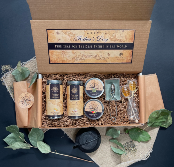 Father's Day Tea Gift Box Set with a Stainless Steel Tea Infuser, 1 Blue-Green Rectangular-Shaped Tea Bag Coaster, 2 Honey Lollipop Tea Sweeteners, 2 Mini Tins, and 2 Tall Tins in the flavors of Earl Grey Supreme Tea and Roobois Chai Herbal Tea